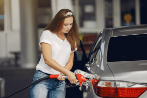 Woman filling her car with gas before heading to vehicle storage.