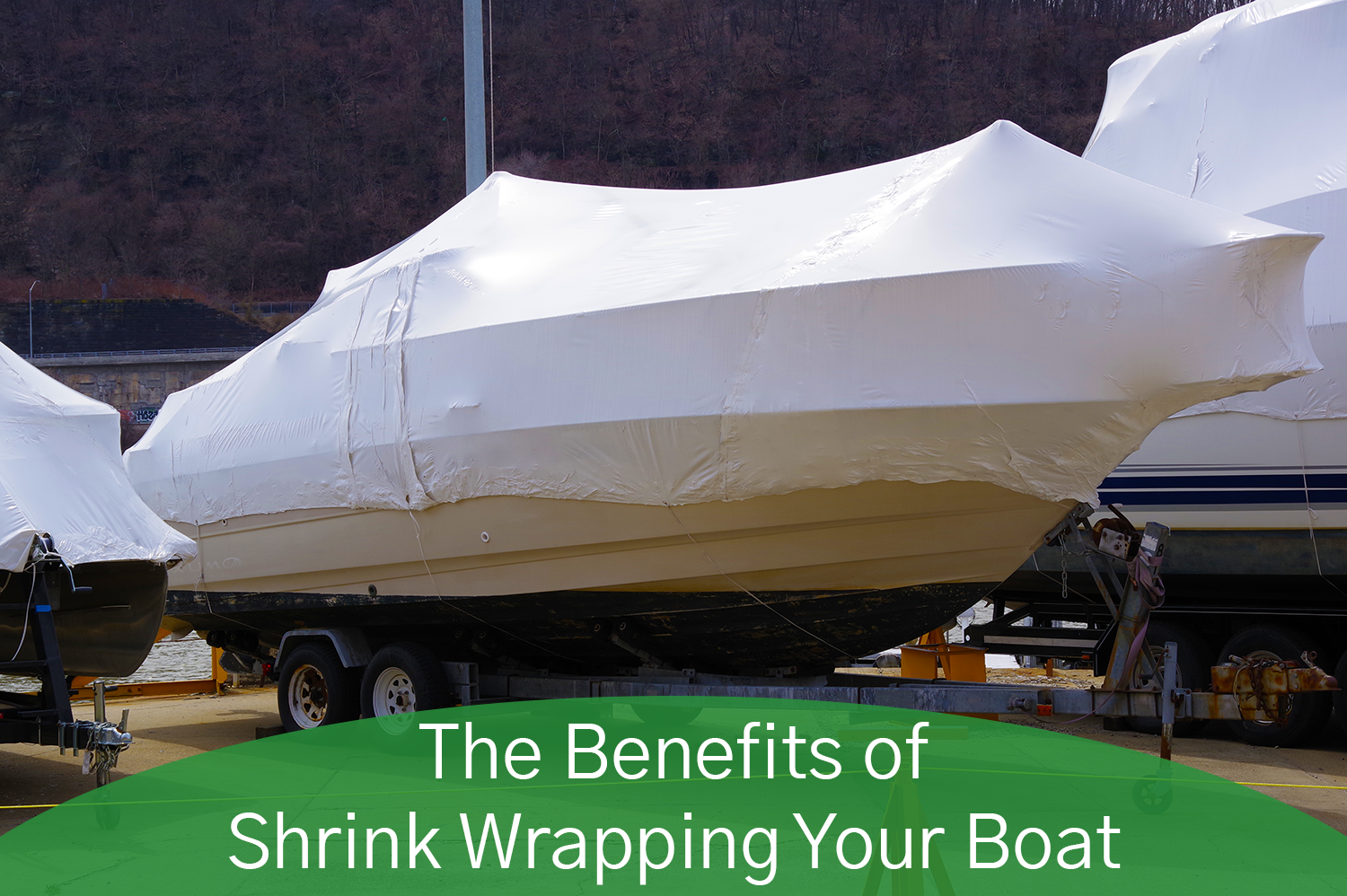 A boat with white shrink wrapping cover it from the elements.